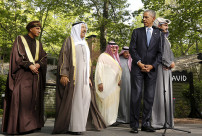 U.S. President Barack Obama looks back toward Oman Deputy Prime Minister Sayyid Fahd bin Mahmoud Al Said (L) and the Emir of Kuwait Sheikh Sabah Al-Ahmed Al-Jaber Al-Sabah (2nd L) while hosting the six-nation Gulf Cooperation Council (GCC) at Camp David in Maryland May 14, 2015.    REUTERS/Kevin Lamarque   - RTX1D0ZQ